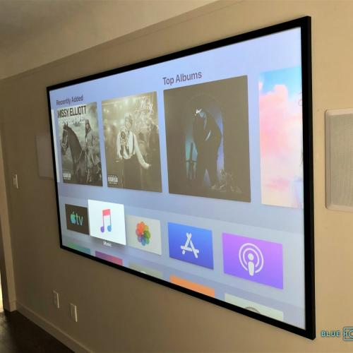 Custom built projector screen and in-wall speakers.